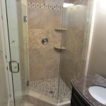 Angled glass shower enclosure installation