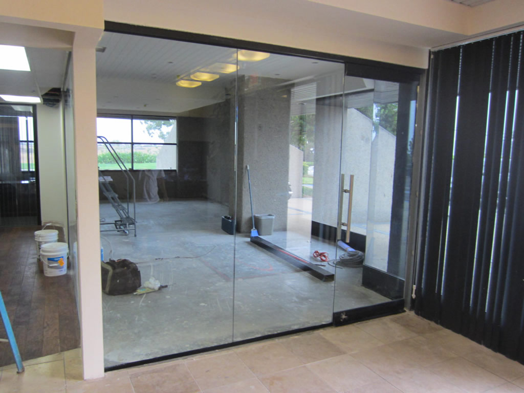 Glass office wall installation patriot glass and mirror for Office wall interior