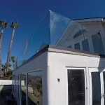 San Clemente Glass Railing With Bronze Base Shoe Installed