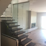 Glass Panel Stairway Railing With Stainless Standoffs