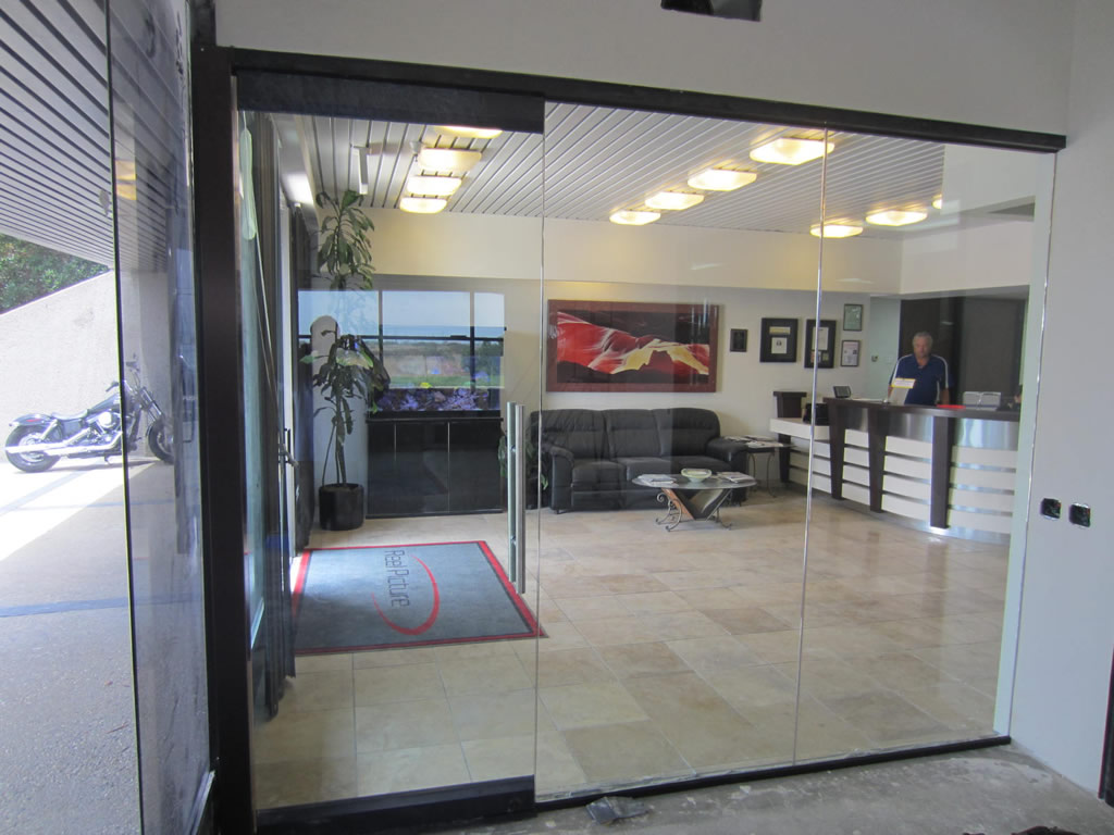 Glass office wall installation patriot glass and mirror for Glass walls and doors